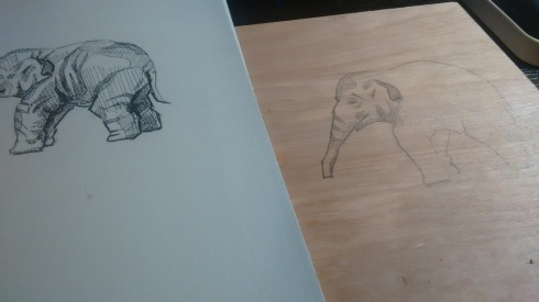Copying my ink sketch of an elephant onto a wood panel